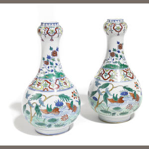 A pair of Chinese famille verte porcelain bottle form vases
