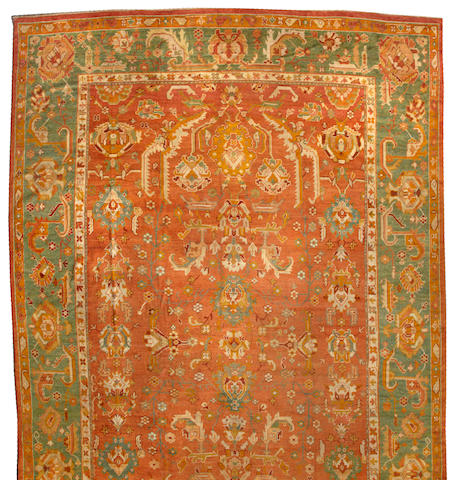 An Oushak carpet West Anatolia size approximately 14ft. x 21ft. 4in.