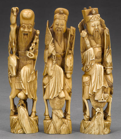 Three carved stag-antler figures of the Three Stars of Happiness 19th century