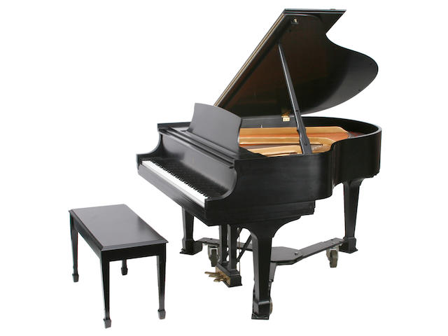 A Steinway and Sons model S ebonized baby grand piano