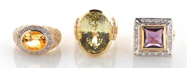 A group of four gem-set and diamond rings in 14k gold, 41.8g