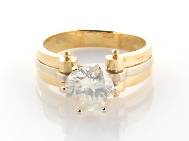 A diamond and 14k bicolor gold solitaire ring