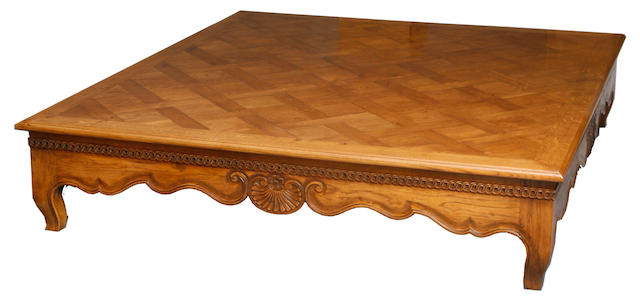 A large Louis XV style mixed wood low table