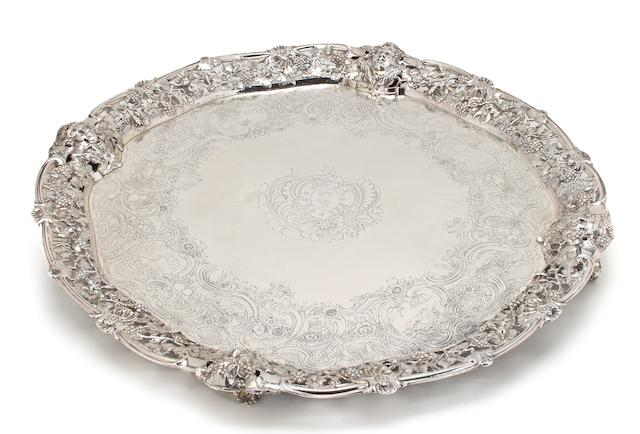 A George II silver salver with applied reticulated cast border with supports William Cripps, London, 1749 <br>With engraved armorial