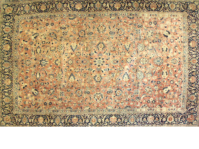 A Kashan carpet size approximately 10ft. 6in. x 16ft. 2in.