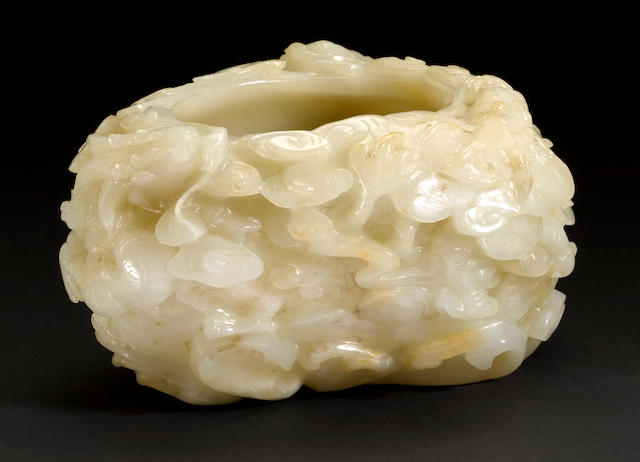 A mottled white jade brush washer with qilin and cloud design 19th century