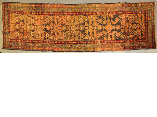 A Kurdish runner size approximately 3ft. 4in. x 11ft. 4in.