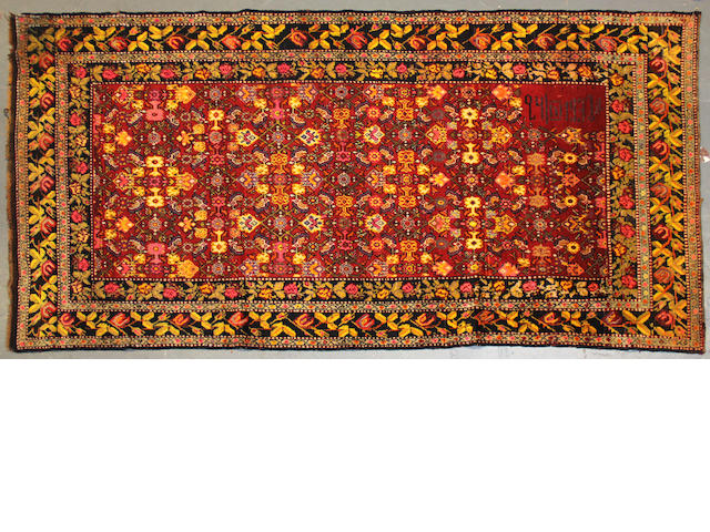 An Armanian runner size approximately 4ft. 9in. x 9ft. 10in.