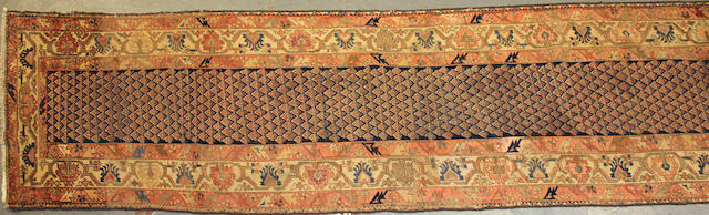 A Malayer runner size approximately 3ft. 3in. x 16ft. 3in.