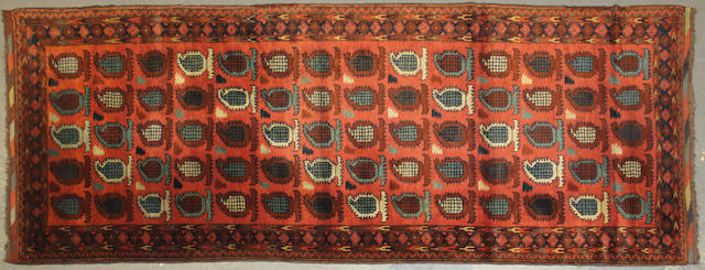 An Afghan runner size approximately 3ft. 8in. x 9ft. 10in.