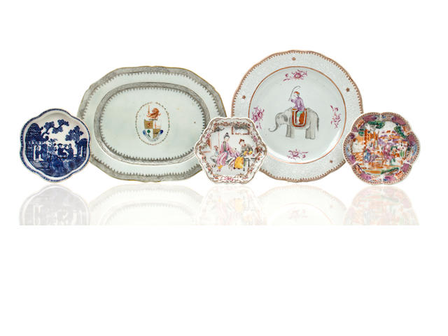 Two Famille Rose tea saucers, Chinese export plave depicting a figure riding an elephant, small Chinese export armorial plate, and a spoon rest