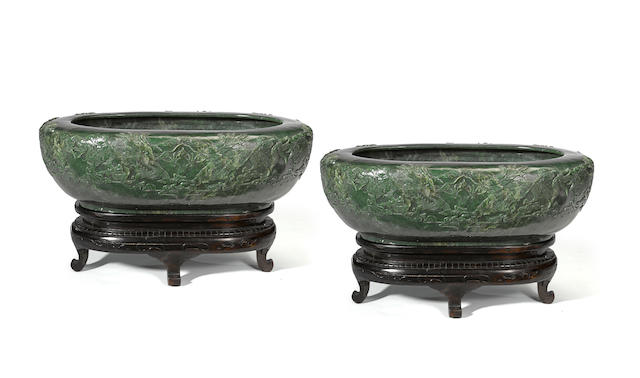 A pair of Chinese spinich Jade Jardineres on stands