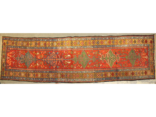 A Serapi runner size approximately 3ft. 3in. x 12ft. 5in.