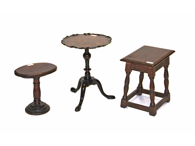 A furniture grouping, including a Baroque style small oak drop leaf table, pair of oval stools, an Elizabethian style joint stool, and a piecrust top table