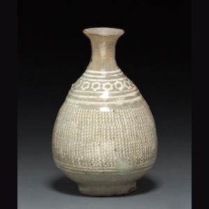 A bunch'eong white slip decorated celadon glazed bottle (restored lip)