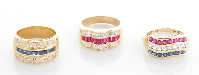 A collection of three ruby, sapphire, diamond, diamond simulant, 18k and 14k gold rings