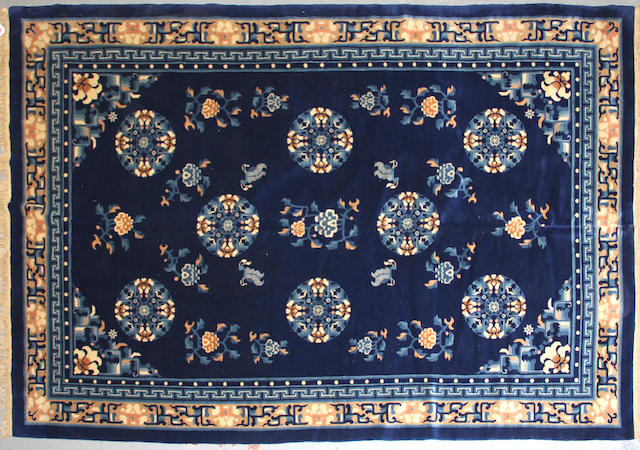 A Chinese carpet size approximately 6ft. 6in. x 9ft. 6in.