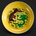 A green and aubergine-glazed yellow ground dragon dish Jiaqing mark and period