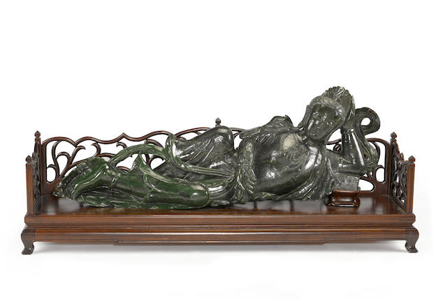 A massive carved green jade reclining figure of Guanyin 20th century
