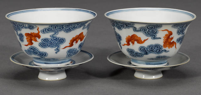 A pair of underglaze blue and iron red enameled bowls and covers Guangxu marks