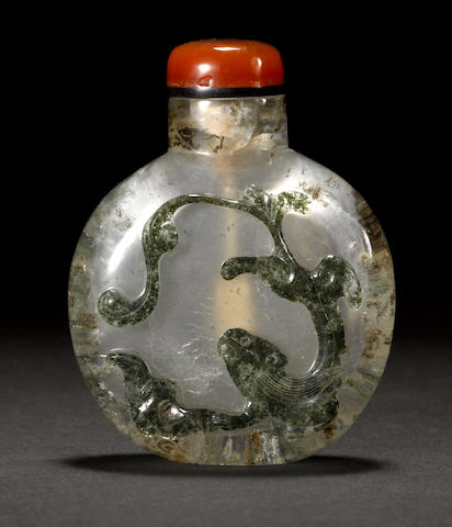 A mottled quartz snuff bottle with raised relief decoration 19th century