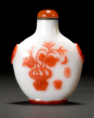 A Peking white milk glass snuff bottle with red overlay decoration 1850-1900
