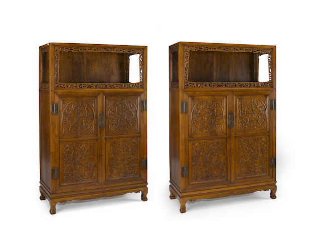 A pair of huanghuali and mixed wood cupcoards with open shelf, bird and flower medallion decoration