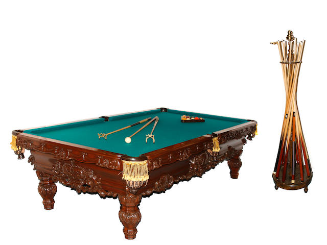 A carved mahogany billiards table