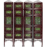 A four-panel wood screen with inset spinach jade panels
