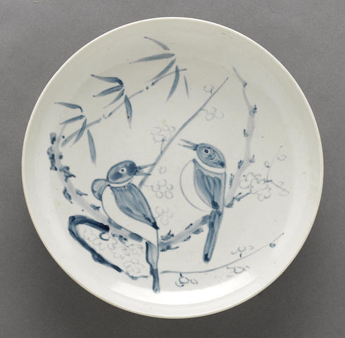 A blue and white porcelain plate with birds and bamboo decoration Korea Joseon Dynasty 19th Century
