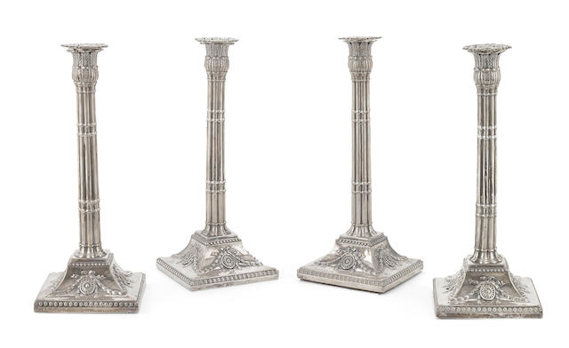 A set of four George III  sterling silver  candlesticks John Carter, London,  1773