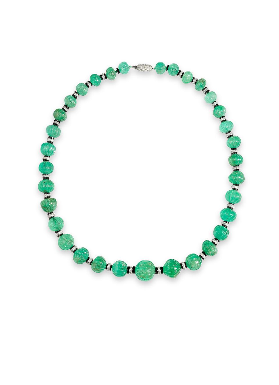 An art deco emerald bead, onyx and diamond necklace, Cartier,