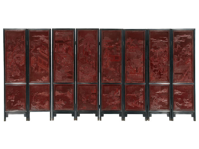 A fine carved Chinese eight panel cinnabar lacquer screen Late 18th/19th century