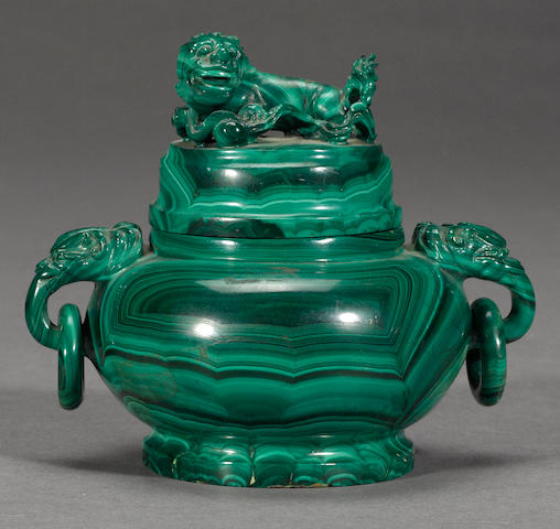 A carved malachite covered censer