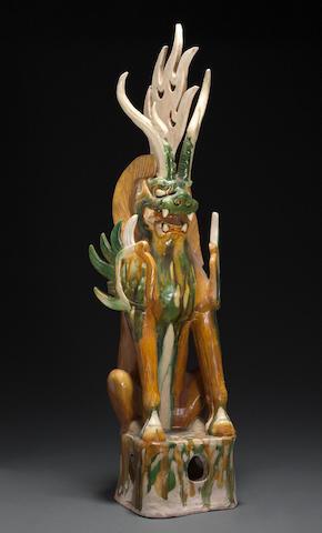 A sancai glazed pottery model of a zhenmu shou with leonine head Tang dynasty