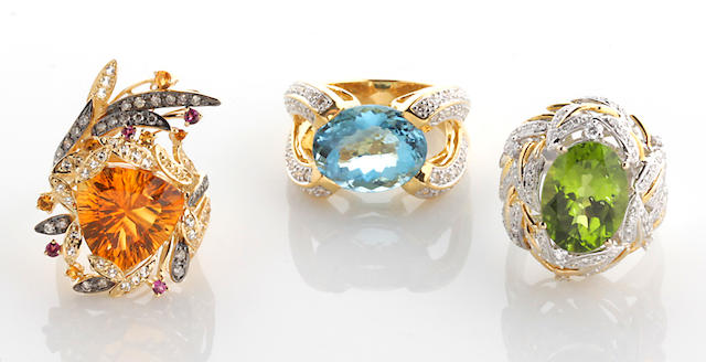 A collection of three gem-set, diamond, 14k and 18k yellow and white gold rings