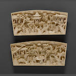 A pair of carved ivory landscape plaques 19th century