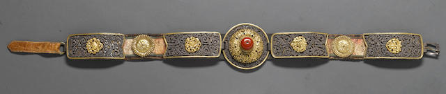 A parcel gilt metal, silver and fabric belt Eastern Tibet or Mongolia, 19th/20th century