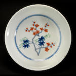 A small doucai enameled porcelain shallow bowl Chenghua mark, Kangxi period