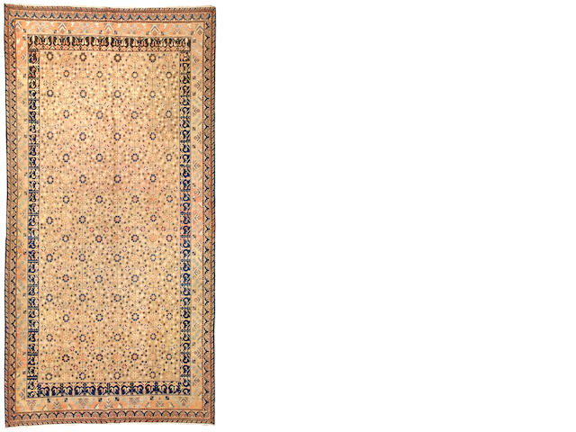 A Khotan rug East Turkestan size appoximately 6ft. 10in. x 13ft. 9in.