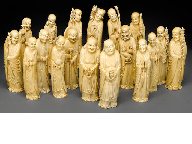 A set of carved and tinted eighteen ivory lohan 20th century