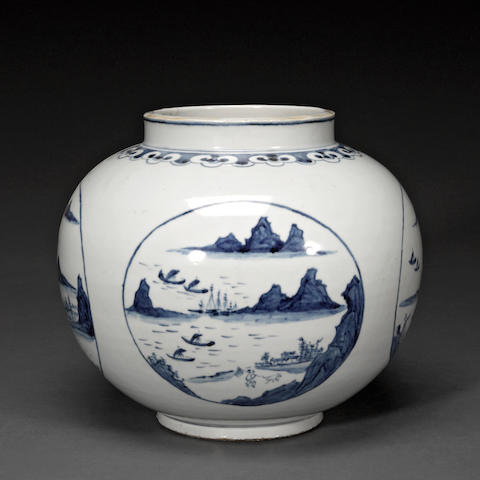 A blue and white porcelain jar with four landscape roundels 20th century