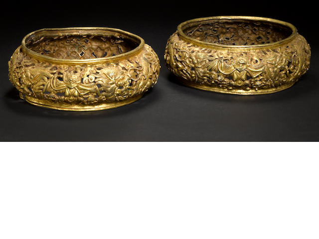 Two Tibeto-Chinese reticulated gilt metal rings 17th/18th century