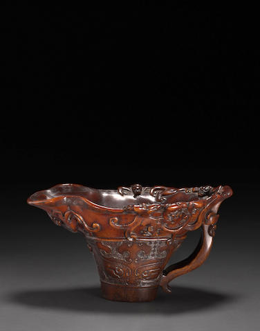 A fine carved rhinoceros horn libation cup  17th century