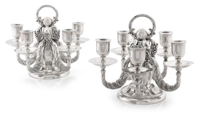 A pair of Georg Jensen sterling silver five light 'Grapevine' candelabra, #383 A, 1945 - 1977
