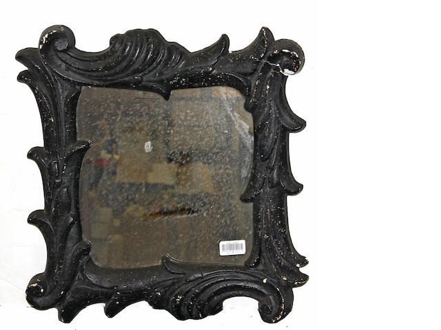 A Frances Elkins design Rococo style black painted mirror
