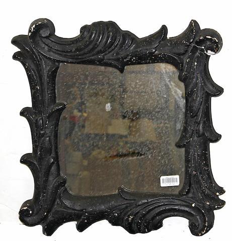 A Frances Elkins design Rococo style black painted mirror
