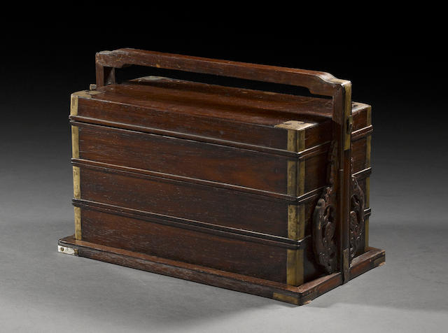 A mixed wood three-tier storage box 19th century