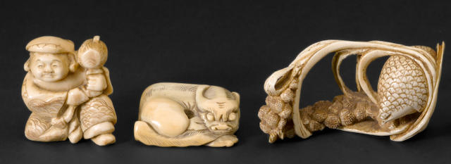 An ivory okimono and two ivory netsuke
