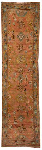 An Oushak runner West Anatolia size approximately 3ft. 2in. x 11ft. 10in.